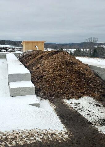 The first bunker of compost made possible through positive aeration