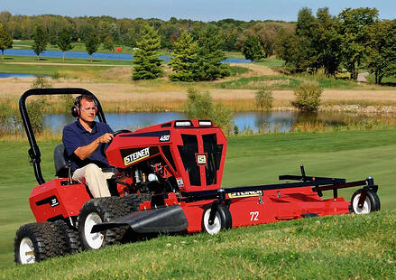 Steiner 450 with rotary mower attachment