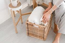 Roll blankets and place into baskets to eliminate untidy piles