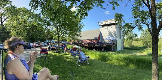 Live music concerts inside the barn and outside help sell plenty of wine and buffalo meat